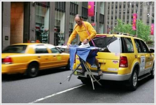 Man ironing on a taxi
