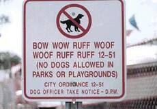 no dogs allowed in parks or playground sign