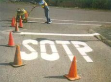 stop spelled wrong on street