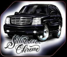 sittin on chromic cadiliac escalade