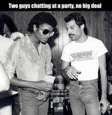 Two guys chatting at a party, no big deal
